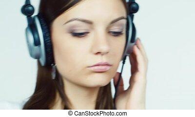 Attractive brunette with headphones lipstick tints