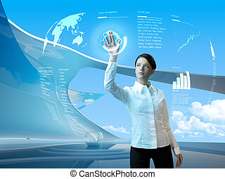 Attractive brunette with interface in futuristic interior -...