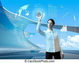 Attractive brunette with interface in futuristic interior -...