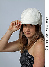 Attractive Brunette with white Cap