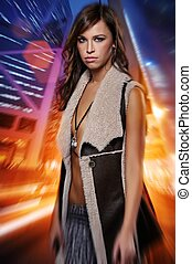 Attractive brunette woman against night city