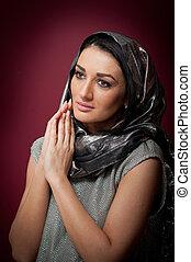 Attractive brunette woman in gray