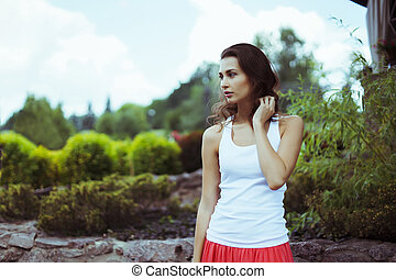 Attractive brunette woman in nature