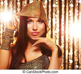 Attractive brunette woman in the night club