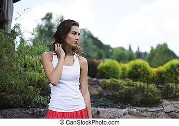 attractive brunette woman in the park