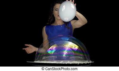 Attractive brunette woman mixing soap bubbles