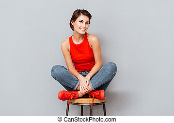 Attractive brunette woman sitting on the chair