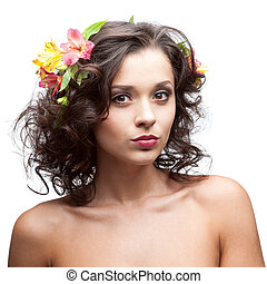 attractive brunette woman with flowers in hair