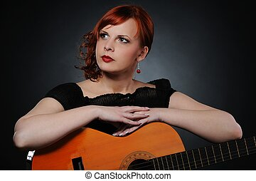 Attractive brunette woman with guitar