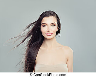 Attractive brunette woman with long healthy hair