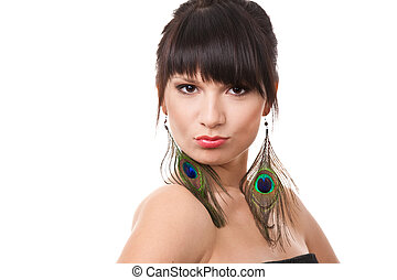 Attractive brunette woman with peacock earrings