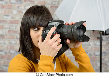 brunette woman with photo camera