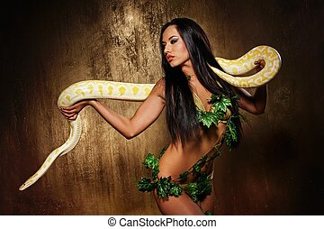 Attractive brunette woman with python