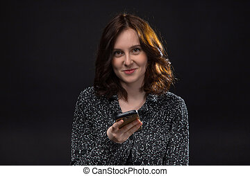 Attractive brunette woman with smartphone