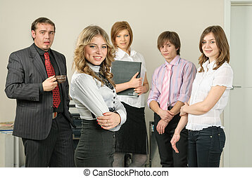 Attractive business lady and her team