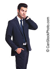 attractive business man looking away from the camera