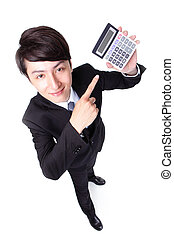 Attractive business man pointing a calculator