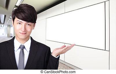 business man shows you empty billboard
