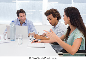Attractive business people at meeting