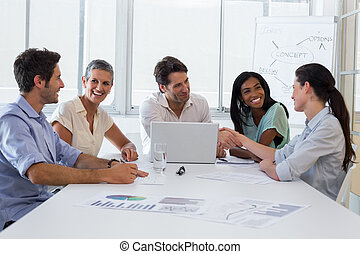 Attractive business people discussing at a meeting -...