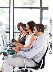 Attractive business people in a call center