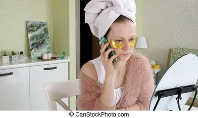 attractive business woman applying cosmetic facial spots at...