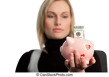 Attractive Business woman holding a piggy bank