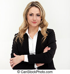 Studio shot of attractive business woman in black suit with arms crossed