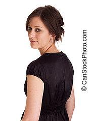 Attractive business woman looking over her shoulder