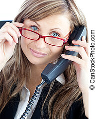 Attractive business woman on phone  wearing red glasses