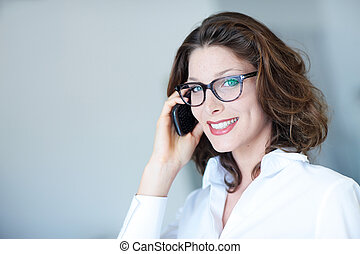 attractive business woman on the phone