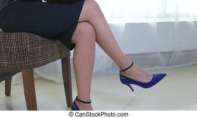 Attractive business woman rubbing tired feet while working