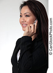 Attractive business woman talking on cell phone