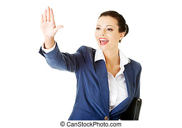 Attractive business woman with hand up looking.
