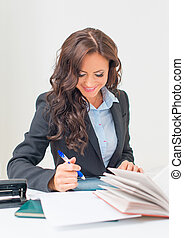 Attractive business woman working with documents in office.