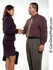 Attractive businessman and businesswoman shaking hands
