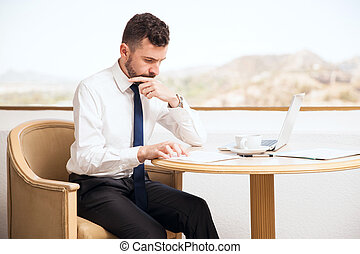 Attractive businessman doing some work