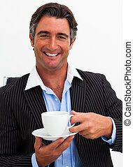 Attractive businessman drinking coffee