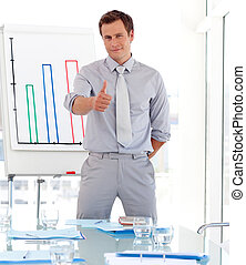 Confident well dresed attractive businessman giving presentation to his colleagues and smiling