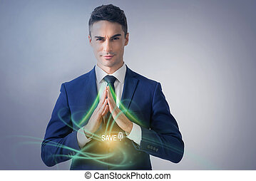 Attractive businessman is demonstrating safety