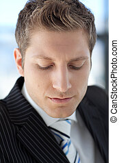 Attractive Businessman looking at camera