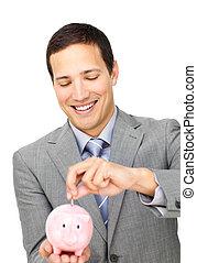 Attractive businessman saving money in a piggy-bank