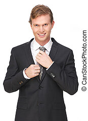 Attractive Businessman Smiling and Holding Tie