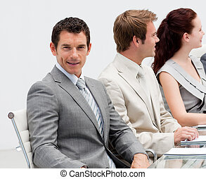 Attractive businessman smiling in a meeting