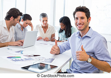 Attractive businessman smiling in t