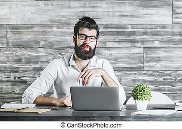 Attractive businessman using laptop computer