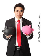 Attractive businessman with piggys