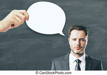 Attractive businessman with thought/speech bubble