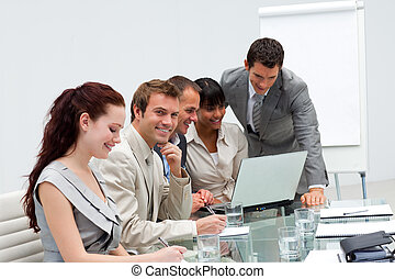 Attractive businessman working with his team