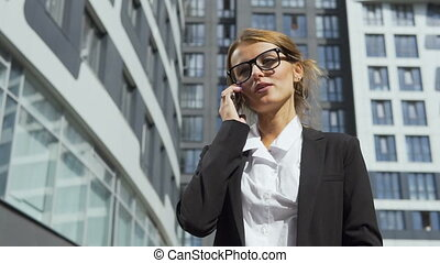 Attractive Businesswoman Answering Phone Call - Good-looking...